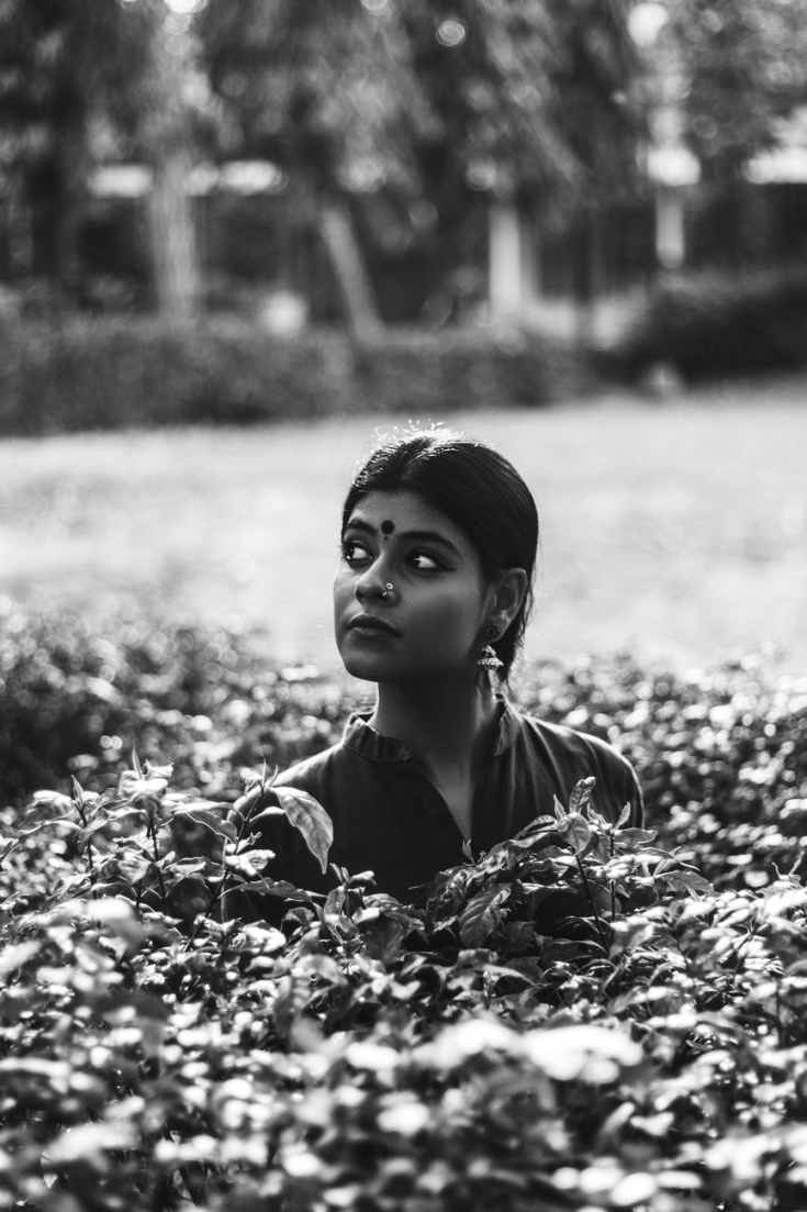 grayscale photography of woman on garden